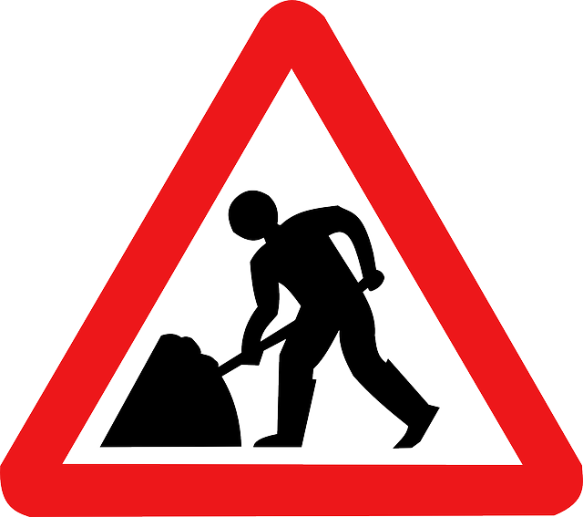 men at work warning sign
