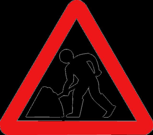 men at work warning sign